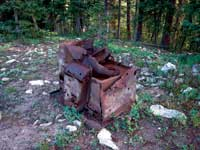 Photo of what appears to be an old rusty wood stove