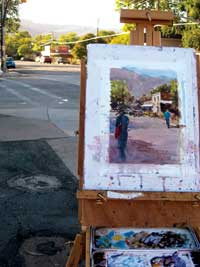 Painters easel and painting on Center Street sidewalks